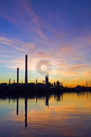 Oil Refinery at sunset stock photo, The silhouette of an oil refinery at sunset, against a radient sky by Corepics VOF