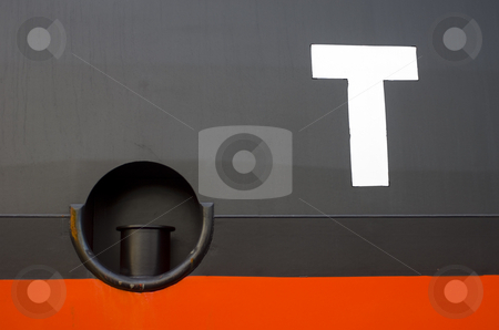 T for Tug stock photo, A huge T on the hull of a container ship next to a mooring post, used for tugs to attach their ropes to by Corepics VOF