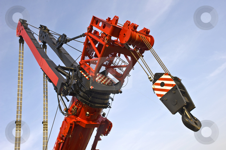Detail of the worlds largest mobile crane stock photo, A close up of the telescopic arm arm of the worlds largest mobile crane with the jigged ams to lift the real heavy stuff. by Corepics VOF