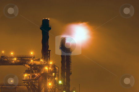 Industrial Inferno stock photo, Nightly scene of an industrial plant with huge flaring stacks by Corepics VOF