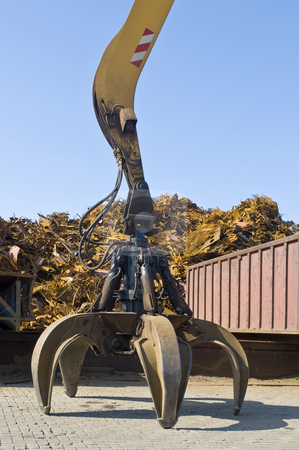 Scrap heap claw stock photo, A claw, attatched to a huge crane in front of a scrap heap by Corepics VOF