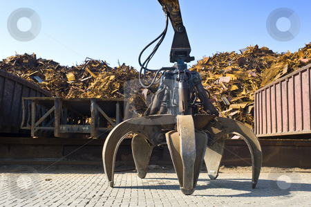 Scrap Heap Claw stock photo, A huge mechanical claw, used to manipulate steel scrap on a scrapheap by Corepics VOF
