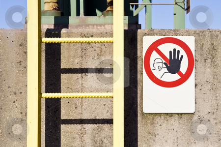 Industrial detail stock photo, A ladder and no access warning sign on a concrete pillar at an industrial plant by Corepics VOF