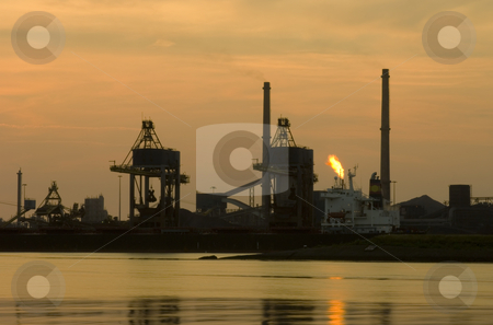 Steel works skyline stock photo, The skyline of a steel plant at dusk by Corepics VOF