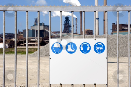 Industrial Zone stock photo, A galvanised steel gate with a safety regulation sign with plenty of copyspace for your own message by Corepics VOF