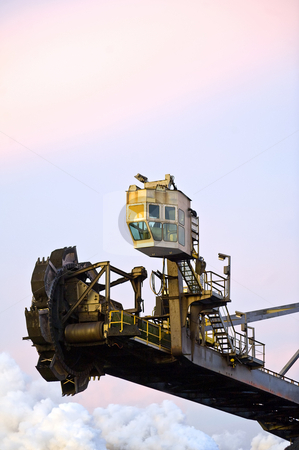Earth Mover stock photo, A huge mining machine, with a flying wheel used to excavate massive amounts of minerals at an industrial site by Corepics VOF