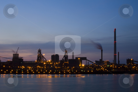 Industrial Dawn stock photo, Steelworks at dawn, seen from across a sluice entrance. An industrial, almost silhouette view of heavy industry. by Corepics VOF