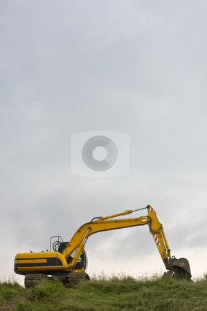 Digger stock photo, A digger on a dyke in Zeeland, the Netherlands, used to reenforce the protection against the sea by Corepics VOF