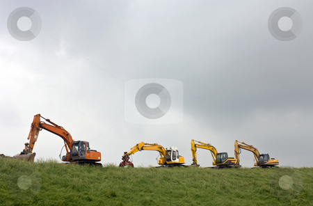 Four diggers on a dyke stock photo, Four diggers on a dyke in Zeeland, the Netherlands by Corepics VOF