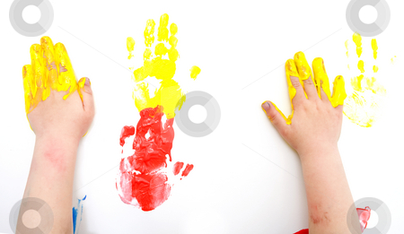 Painted Hans stock photo, The hands of a young boy with finger paint by Corepics VOF