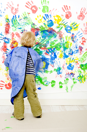 Finger painter stock photo, A young boy enjoying himself at fingerpainting by Corepics VOF