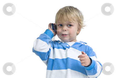 Boy calling with a cell phone stock photo,  by Corepics VOF