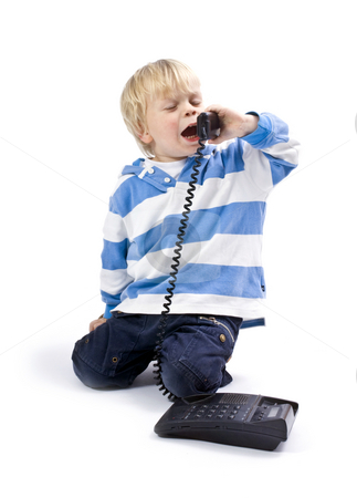 Small boy on the phone stock photo, A small boy, 3 years old, talking on the phone by Corepics VOF