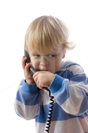 Boy on phone stock photo, A small, 3 year old boy whispering on the telephone by Corepics VOF