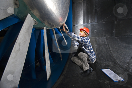 Inspecting the windtunnel stock photo, An engineer, wearing the appropriate protective gear, examining the rotor of an industrial windtunnel facility by Corepics VOF