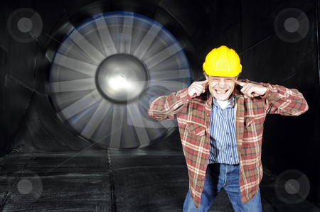 Inside a windtunnel stock photo, An engineer, covering his ears to protect them from the noise of a wintunnel being tested by Corepics VOF