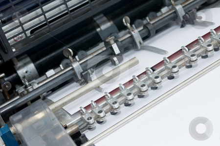 Offset sheet feeder stock photo, The sheetfeeder of an offset printing press by Corepics VOF