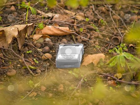 Environmental - Urban pollution , cigarette pack in the bush stock photo, Environmental - Urban pollution , cigarette pack in the local bush by Phillip Dyhr Hobbs