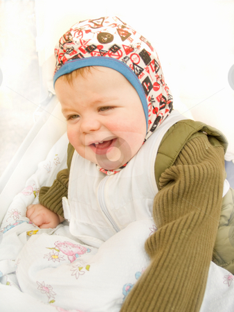 Cute happy baby boy sitting and laughing stock photo, Cute happy baby boy sitting and laughing happily by Phillip Dyhr Hobbs