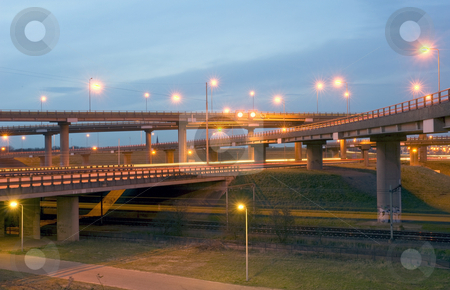 Autobahn Junction stock photo, The various motorways crossing at differtn levels of a massive motorway junction at dusk by Corepics VOF