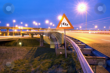 Motorway wind warning stock photo, The windvane on a sign, warning the traffic for heavy winds on the motorway overpass by Corepics VOF