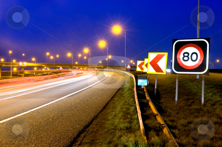 Highway Signs stock photo, The warning signs on a motorway junction at night by Corepics VOF