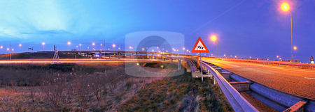 Highway junction stock photo, A panoramic view on a huge highway junction near Den Haag, the Netherlands at dusk by Corepics VOF