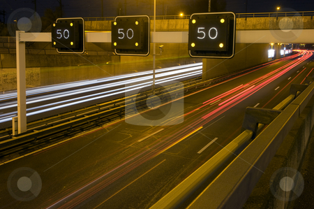 Motorway Information System stock photo, Motorway Information System indicating a speed limit and traffic jam ahead by Corepics VOF