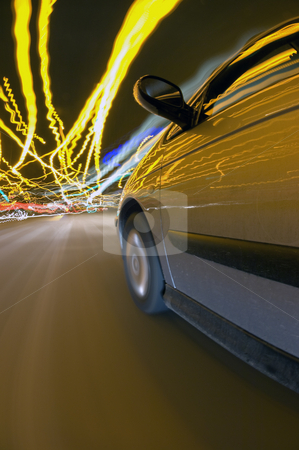 Downtown Driving Chaos stock photo, A car finding its way through the downtown traffic amidst the clutter of lights by Corepics VOF