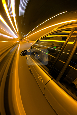 Midnight Drive stock photo, A car, seen from the outside, racing along a motorway at night by Corepics VOF