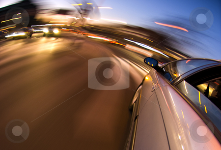 Inner City Driving stock photo, A car driving in the busy downtown streets, with taking a right turn by Corepics VOF