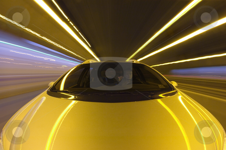 Highway Speeding stock photo, A car, seen from the front racing at high speeds along a straight motorway by Corepics VOF