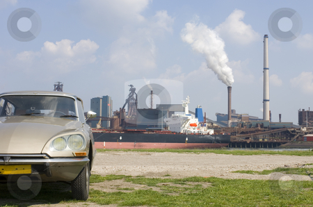 Citroen DS and Steel works stock photo, An 1973 Citroen DS contrasting with the steel works in the rear. by Corepics VOF