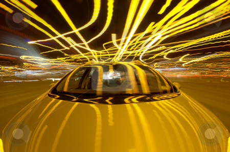 Driving Chaos stock photo, A car driving through the frantic traffic of a busy city during rush hour (Quadruple exposure) by Corepics VOF