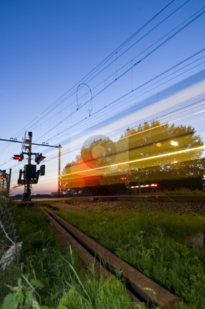 Ghost train stock photo, A train passing a railway crossing at night by Corepics VOF