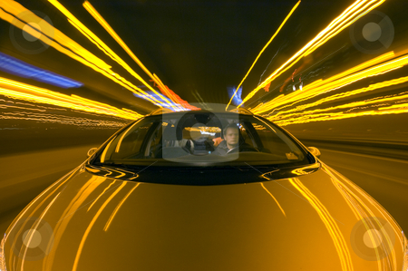 Night Drive stock photo, A car driving on the motorway at night by Corepics VOF