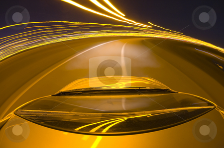 Around the bend stock photo, A car driving at high speed around a motorway bend at night by Corepics VOF