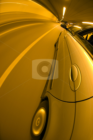 Driving in a tunnel stock photo, A car driving at high speed trhoug a tunnel by Corepics VOF