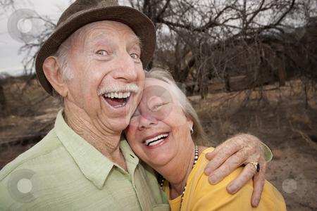 Happy Senior Couple Outdoors stock photo, Happy Senior Couple Outdoors Smiling and Laughing by Scott Griessel