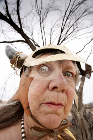Crazy Viking Lady stock photo, Crazy old woman wearing a Viking helmet by Scott Griessel