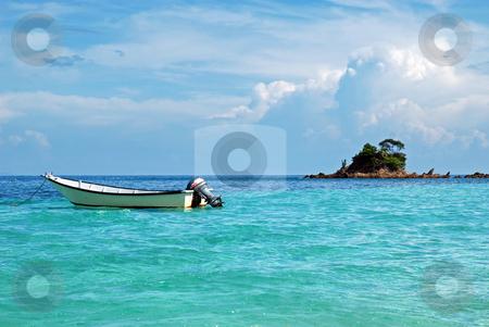 Boat and Island stock photo, Kapas Island by Norazshahir Razali