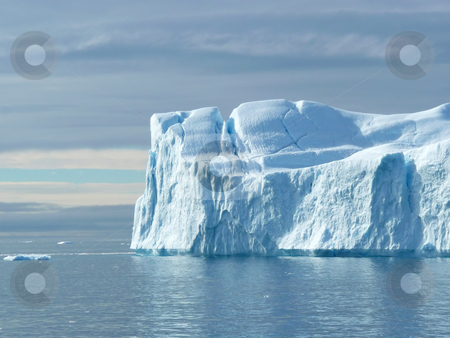 Large Flat Ended Iceberg stock photo, Big blue iceberg looks more like a white cliff. In the seas near Greenland by Helen Shorey