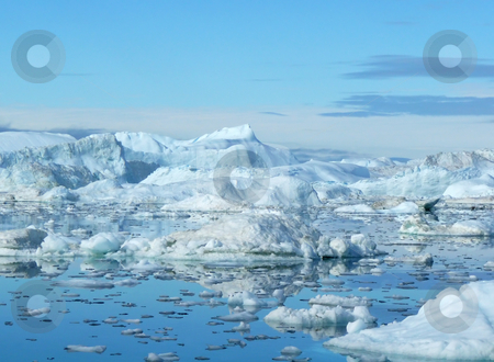 Iceberg Landscape stock photo, Large and small icebergs with small bits of ice in the mirror-like water - Greenland coast by Helen Shorey