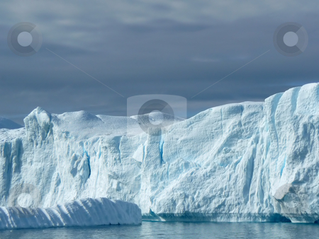 Iceberg 3 stock photo, Part of a large iceberg off the coast of Greenland. Looks more like a cliff face. by Helen Shorey