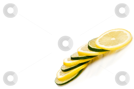 A tilted  horizontal close-up of juicy fresh cut lemon and lime  stock photo, A tilted  horizontal close-up of juicy fresh cut lemon and lime slices with space for copy by Vince Clements