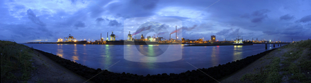 Steel works skyline stock photo, The skyline of a huge steel production plant at twilight by Corepics VOF