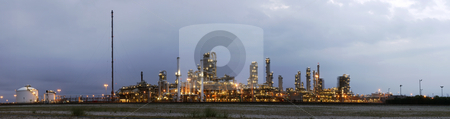 Petrochemical industry at dawn stock photo, A 22 stitched image panoramic of a petrochemical plant at a grey, gloomy dawn by Corepics VOF