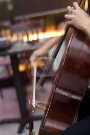 Woman Playing Cello stock photo, A woman sitting down and playing the cello live by Ben Havilland
