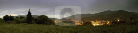 Overcast Nyons Cityscape stock photo, A panoramic image of the town of Nyons, Drome en Provence, in France at night, with thunderous clouds overhead by Corepics VOF