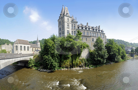 Durbuy Castle stock photo, The famous castle of Europe's smallest city, Durbuy in Belgium, with the old church and imposing geological rock formation on the left, situated on the river Ourthe. 